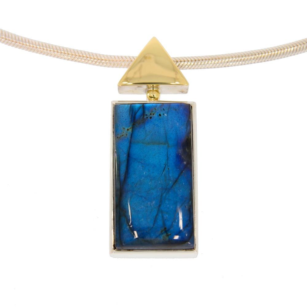 Labradorite silver pendant with triangle of gold decor.