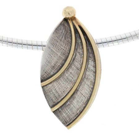 Oxidised silver leaf pendant with gold wire decor. Designed and made by JMK Goldsmiths, Kilkenny