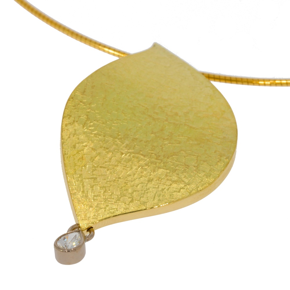 Leaf pendant in 18ct gold with pear diamond. Designed and made by JMK Goldsmiths, Kilkenny