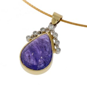Gold pendant with tanzanite and diamonds. Designed and made by JMK Goldsmiths, Kilkenny.