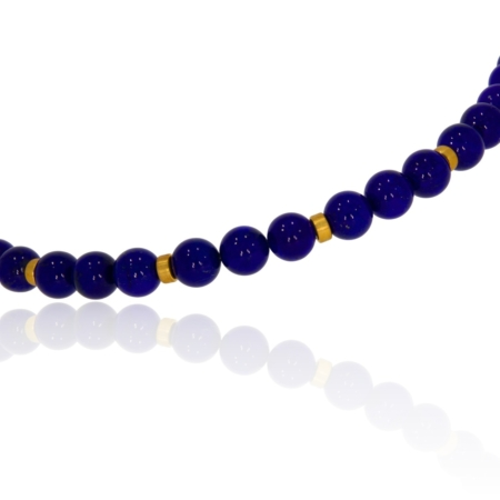 Close up of beaded lapis lazuli and gold necklace with S hook clasp