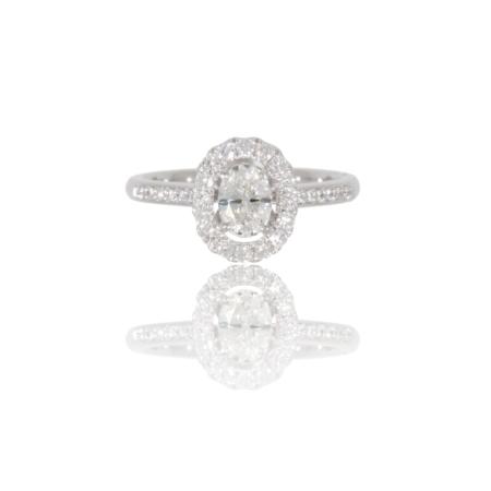 Diamond palladium ring with an oval centre diamond and diamond surround