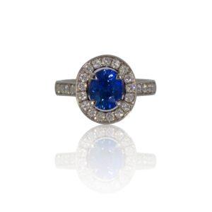 Oval ceylon sapphire platinum ring with diamond surround.