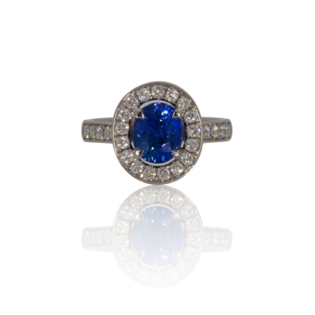 Oval ceylon sapphire platinum ring with diamond surround.