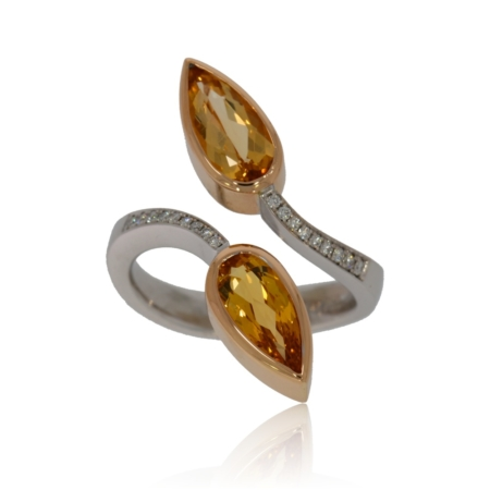 White gold open ring with two pear shaped topaz and pave-set diamonds