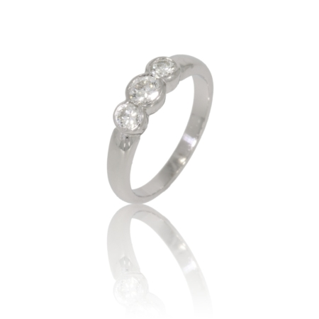Three stone bezel set diamond white gold diamond ring