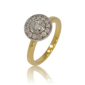 Brilliant diamond gold ring with diamond surround