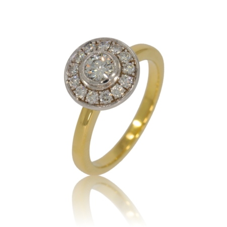 Brilliant diamond gold ring with diamond surround