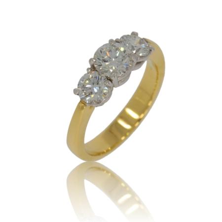 Three stone brilliant diamond and gold ring