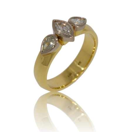 Three stone diamond gold ring with marquise and pear diamonds