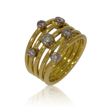Five band gold ring with six diamonds