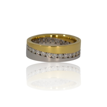 Flat yellow and white gold band with a flow of diamonds around the full band
