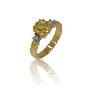 Three stone yellow sapphire and diamond gold ring