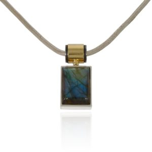 Labradorite silver pendant with gold tube decor.