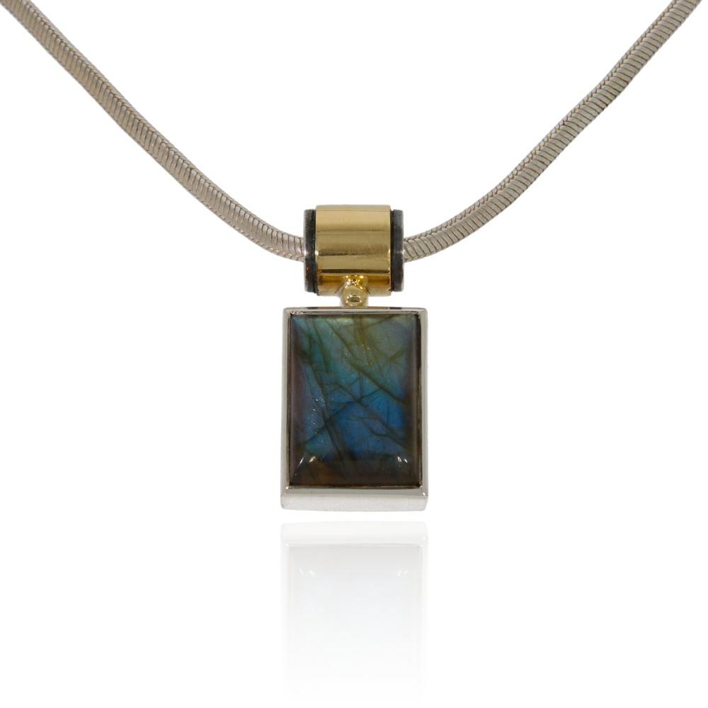 Labradorite silver pendant with gold tube decor.