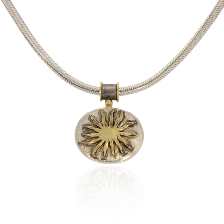 Silver pendant with gold sunshine decor.