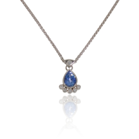 Pear shaped tanzanite and diamond white gold pendant.
