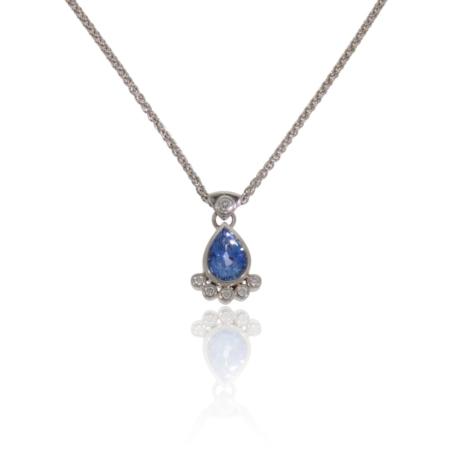 Pear shaped tanzanite and diamond white gold pendant.