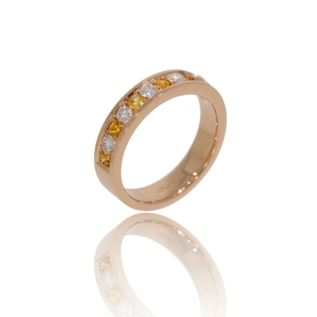 Pink gold ring with diamonds and yellow sapphires