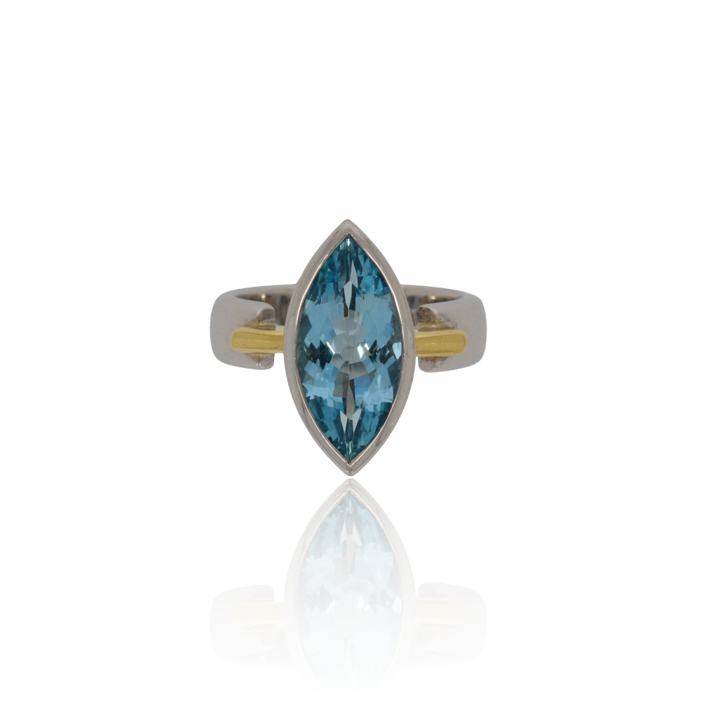 Marquise cut aquamarine on a white and yellow gold ring.