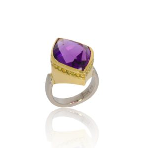 Amethyst gold ring with fancy yellow diamonds. White gold band and yellow gold setting