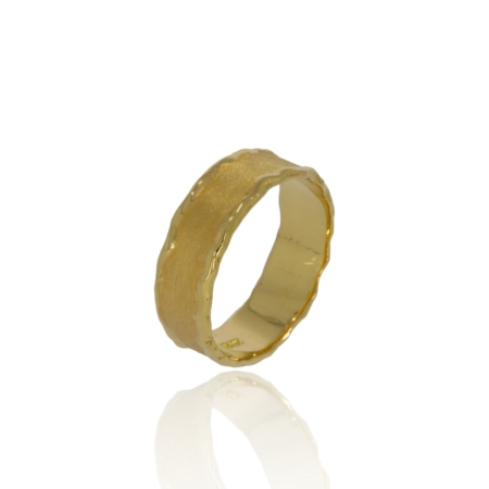 Gold ring with textured finish and contrasting melted edges
