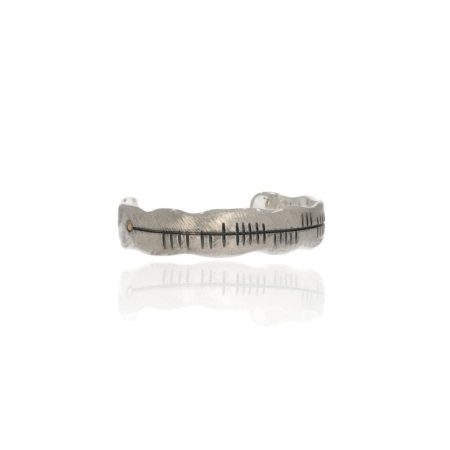 Oxidised silver ogham bangle with gold decor