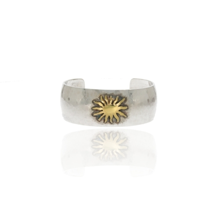 Silver bangle with sunshine gold motif