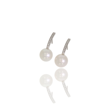 Long white gold pearl and diamond drop earrings.