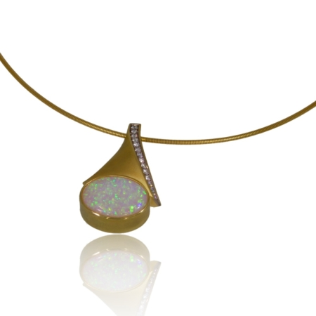 Yellow gold opal pendant with a row of diamonds.