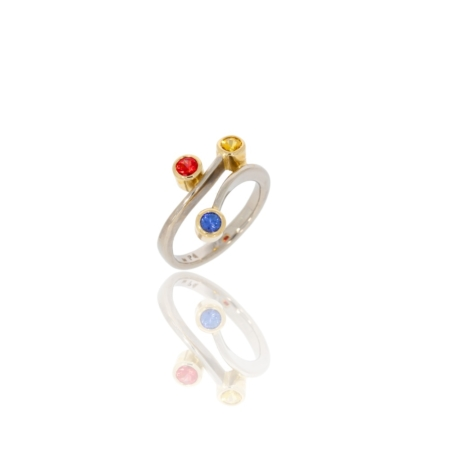 Hand-forged palladium twist ring with red, blue and yellow sapphires