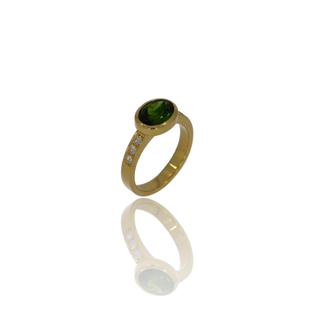 Gold ring with forest green tourmaline and diamonds.