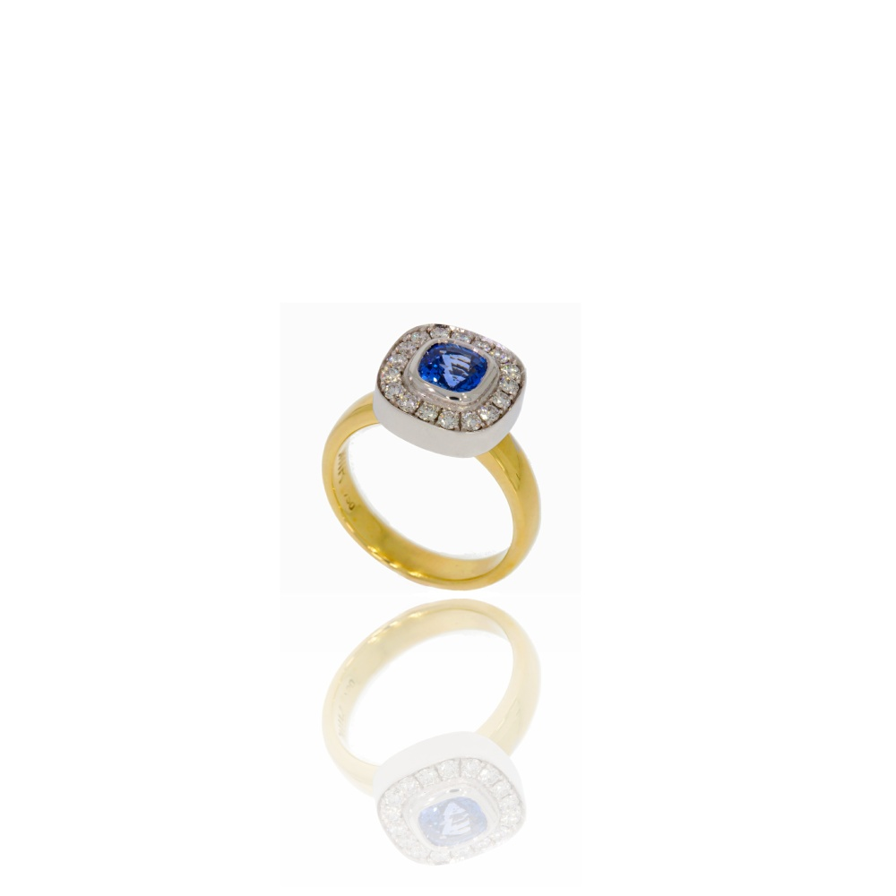Gold Ring with sapphire centre and a surround of diamonds
