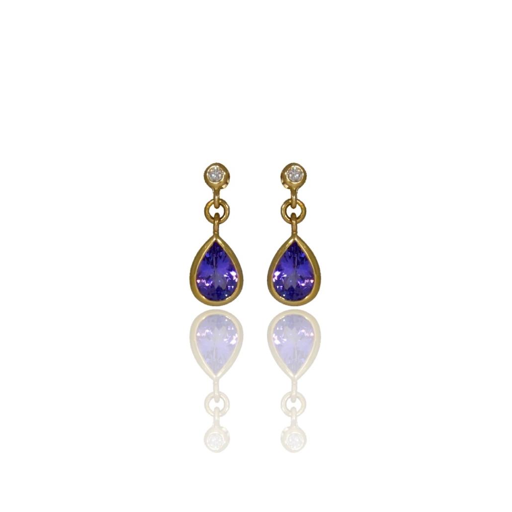 Pear tanzanite and diamond drop earrings in gold