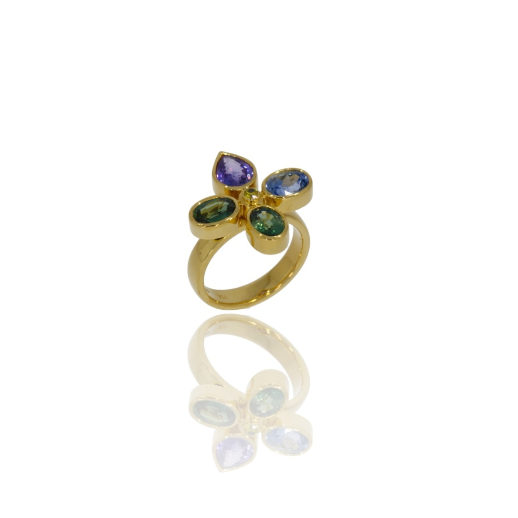 18ct yellow gold ring with four multi-coloured sapphires in shades of green, blue and violet.