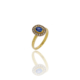 Yellow gold ring with a central oval sapphire and a diamond halo surround