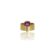 Yellow gold band with an oval pink tourmaline set to the side of the band and three diamonds set across the band from the middle of the tourmaline