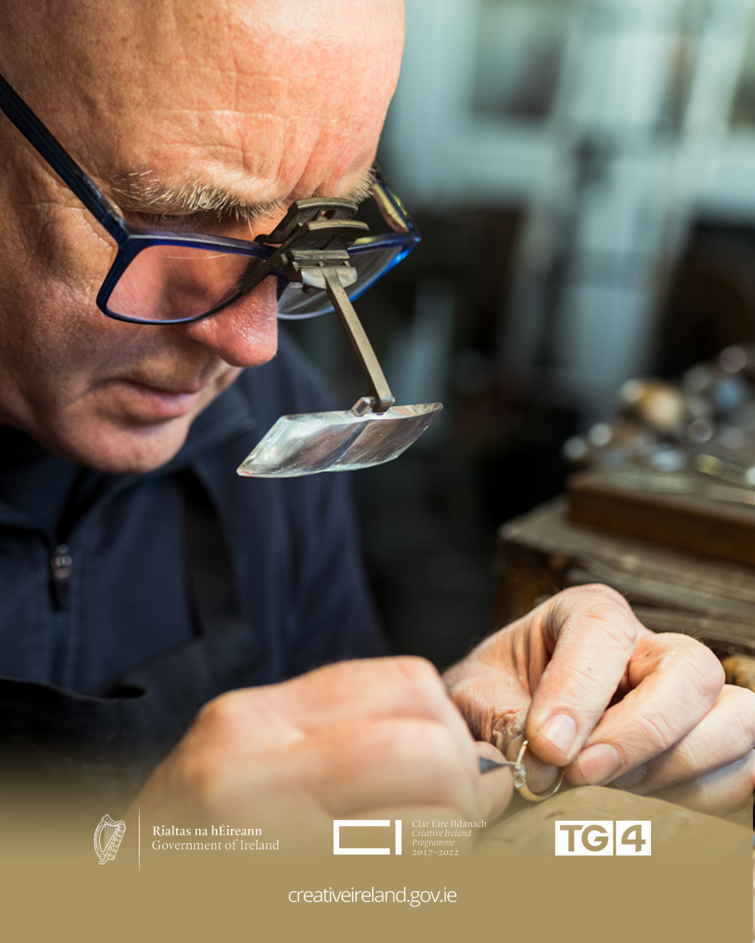 James Kelly, owner of JMK Goldsmiths working at his goldsmith's bench in Kilkenny, Ireland