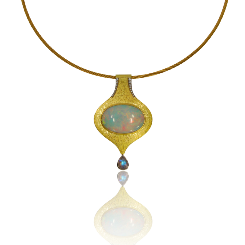 Gold pendant with an oval Ethiopian opal set horizontally, teardrop moonstone at base of pendant and two rows of diamonds at the top set lengthways
