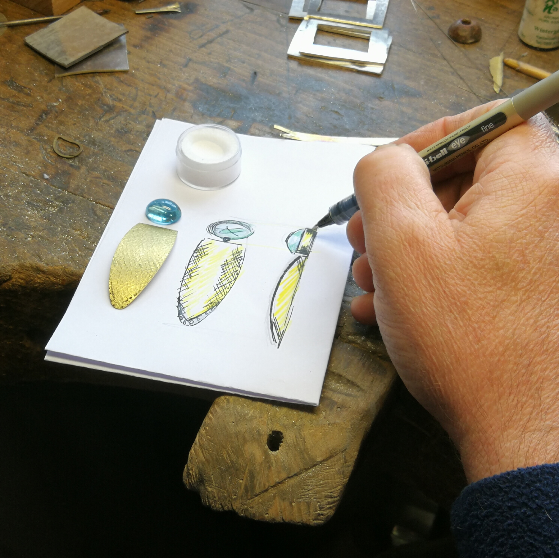 James Mary Kelly, owner of JMK goldsmiths sketching new designs at his workshop in Kilkenny, Ireland