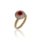 Gold ring with a round Indian ruby and a halo of diamonds surrounding it on a rose gold band