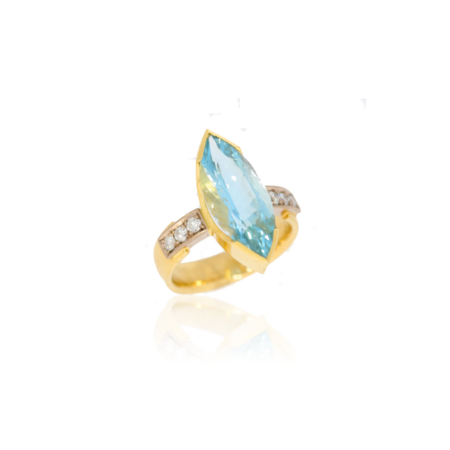 Yellow gold ring with marquise cut aquamarine with 6 pave set diamonds in white gold